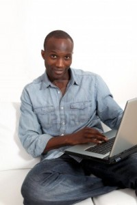 9638835-smiling-man-websurfing-on-laptop-computer-at-home