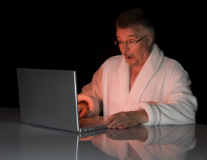 Man looking shocked at computer